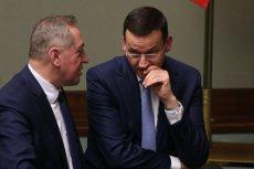 """Wicepremier Mateusz Morawiecki (z prawej) jest """"rozczarowany"""" prezydenckim wetem."""