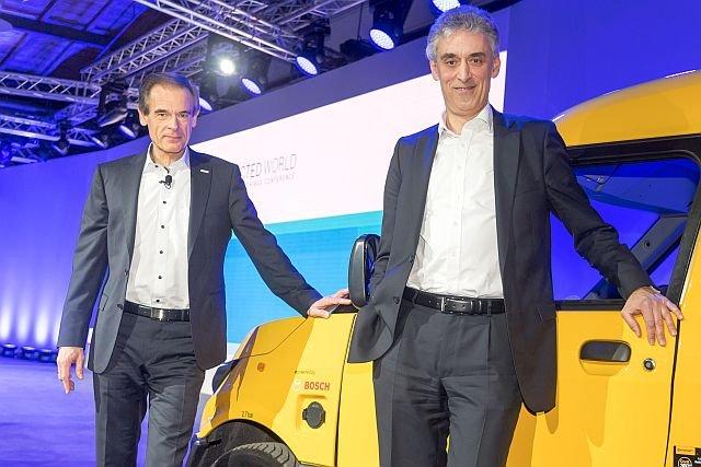 Frank Appel (z prawej) uczynił z niemieckiej poczty zaawansowany biznes technologiczny, pełen technicznych nowinek, a jednocześnie bardzo dochodowy
