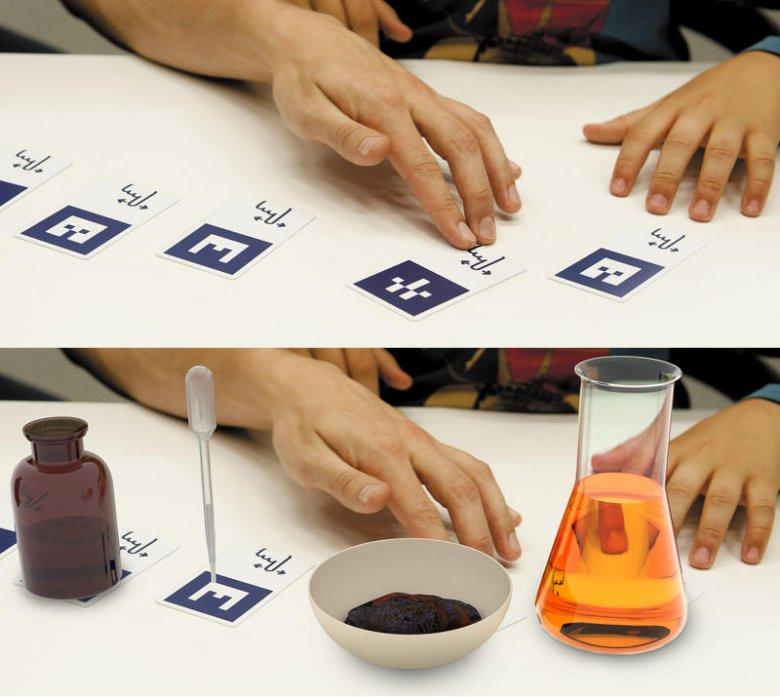 Karty zamieniają się na ekranie w przyrządy laboratoryjne.
